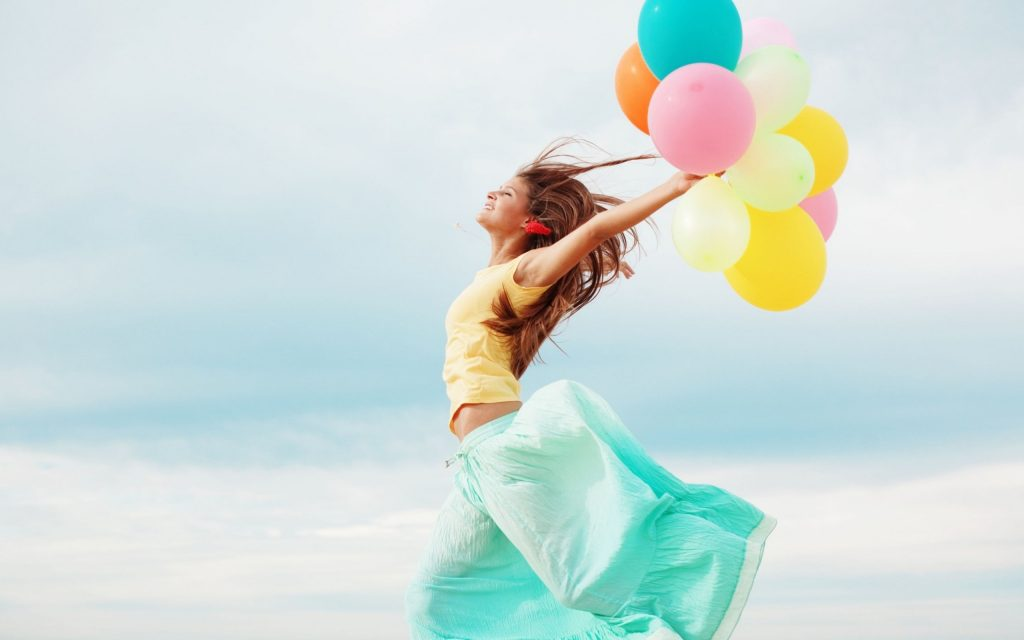 mood-girl-is-running-holding-colorful-balloons