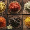 Different tipes of spice on wooden boards.