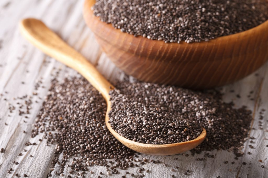 Healthy Chia seeds in a wooden spoon close-up. horizontal